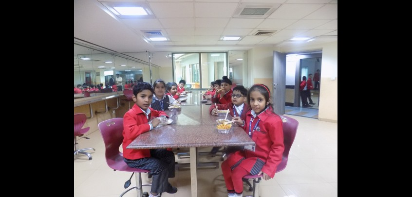 school with cafeteria, student of junior wing having their meal in cafeteria