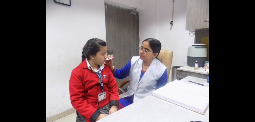 the image shows a doctor is checking up a primary wing student,best school for primary class