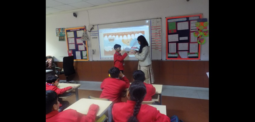 school with smart classes,teacher is teaching students with the help of smart class
