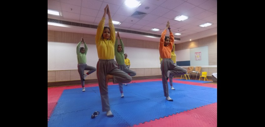 yoga room in school,image shows students are doing yoga